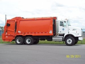 Orange residential garbage truck from June 29, 2011